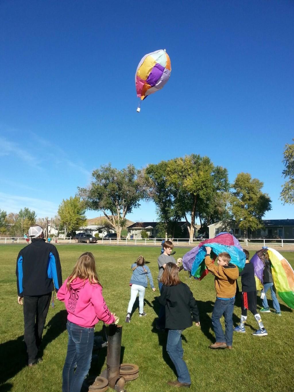 Students watching a hot air balloon