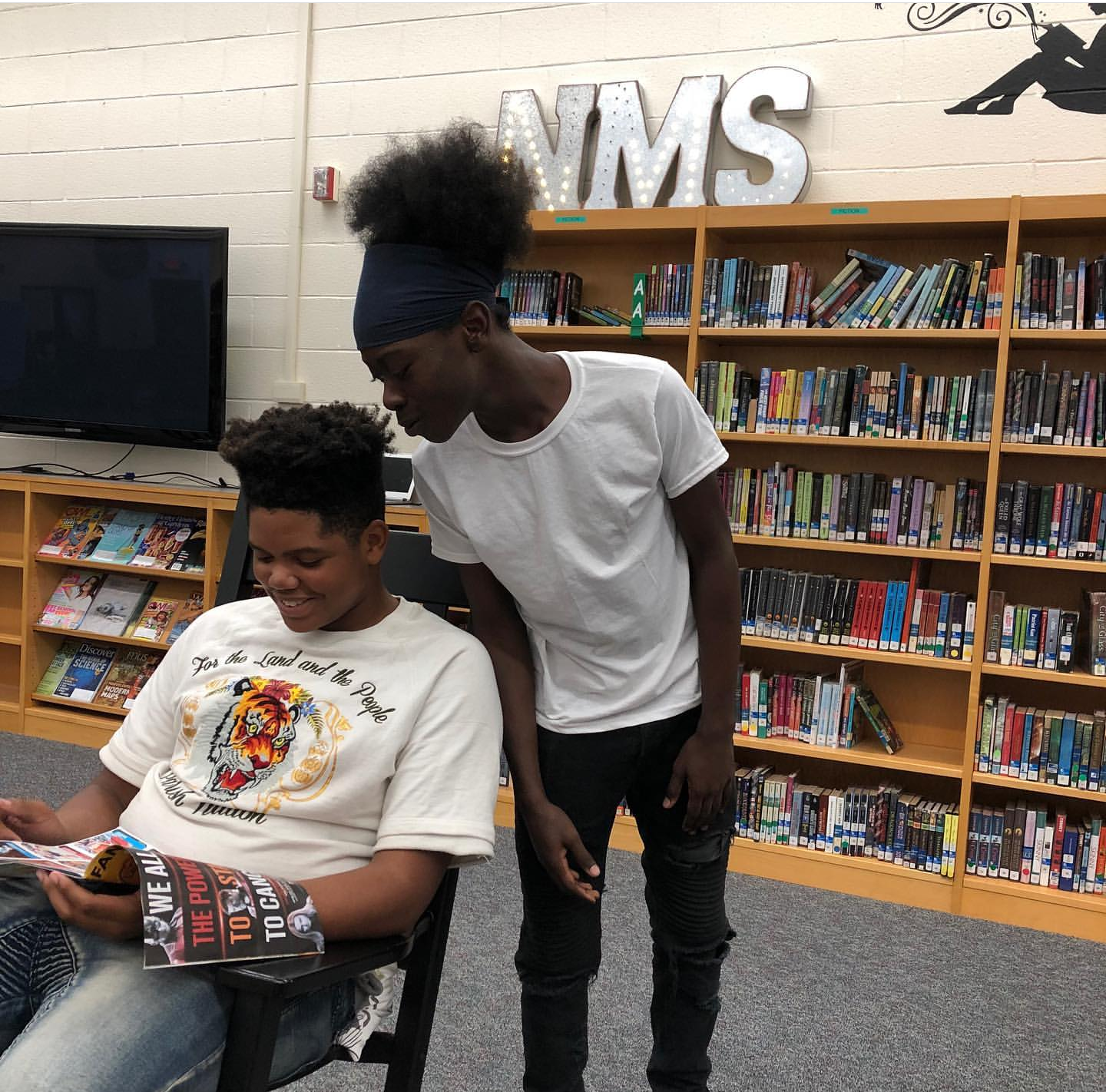 Ms. Hassell's students sharing a magazine