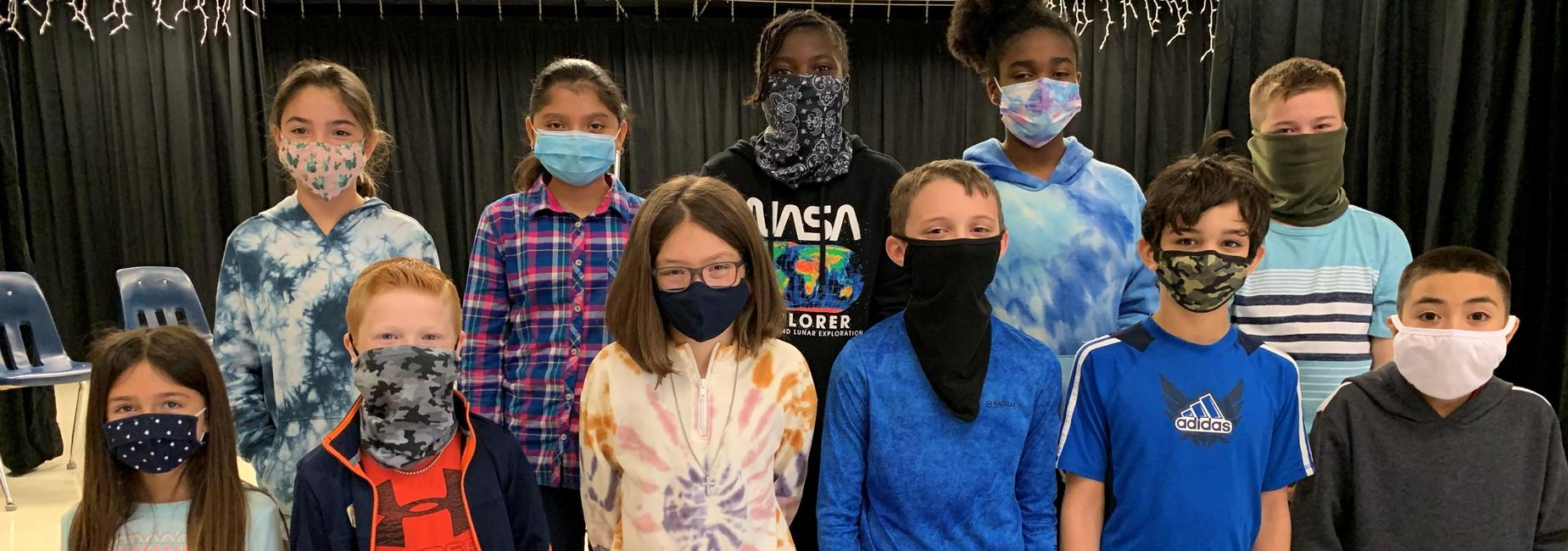 group of kids wearing facemasks