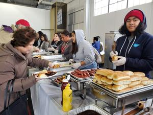 Students helping to serve at a buffet line