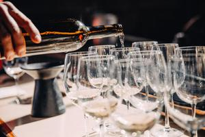 Wine pouring into glasses
