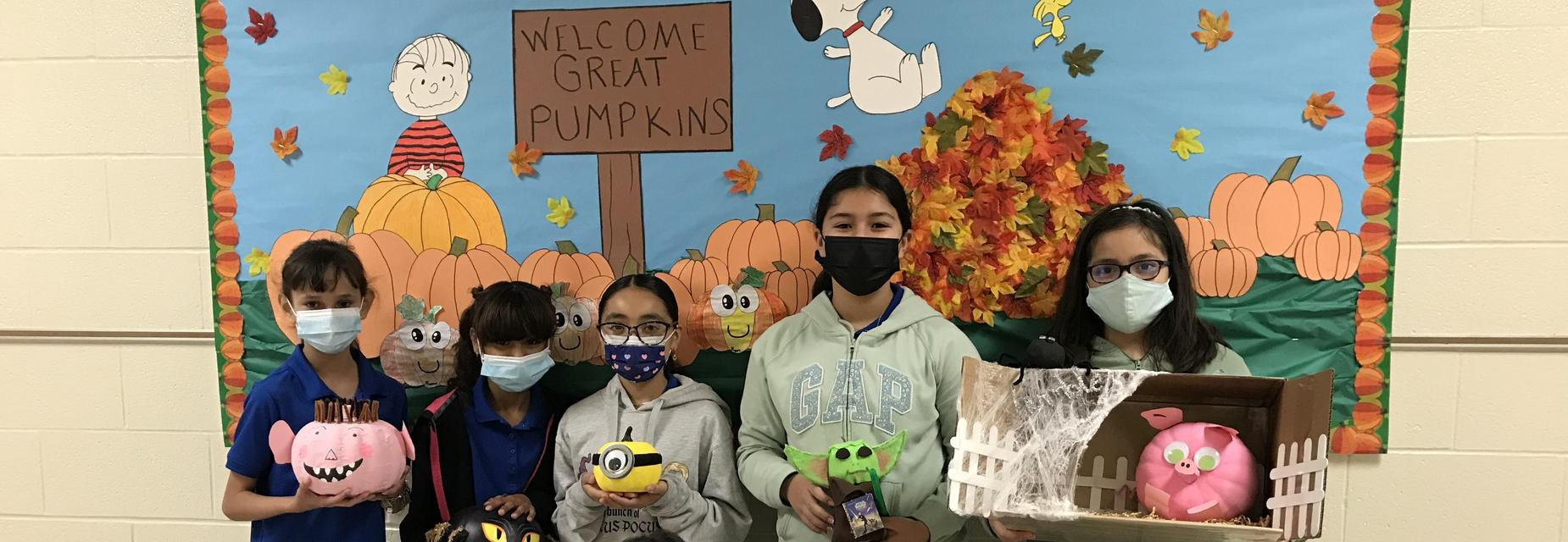 5th graders with pumpkin characters