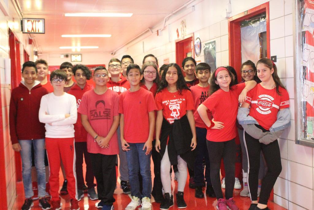 Seventh Grade wears red