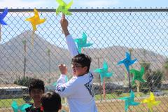 Students posted pinwheels on the fence for child abuse awareness.
