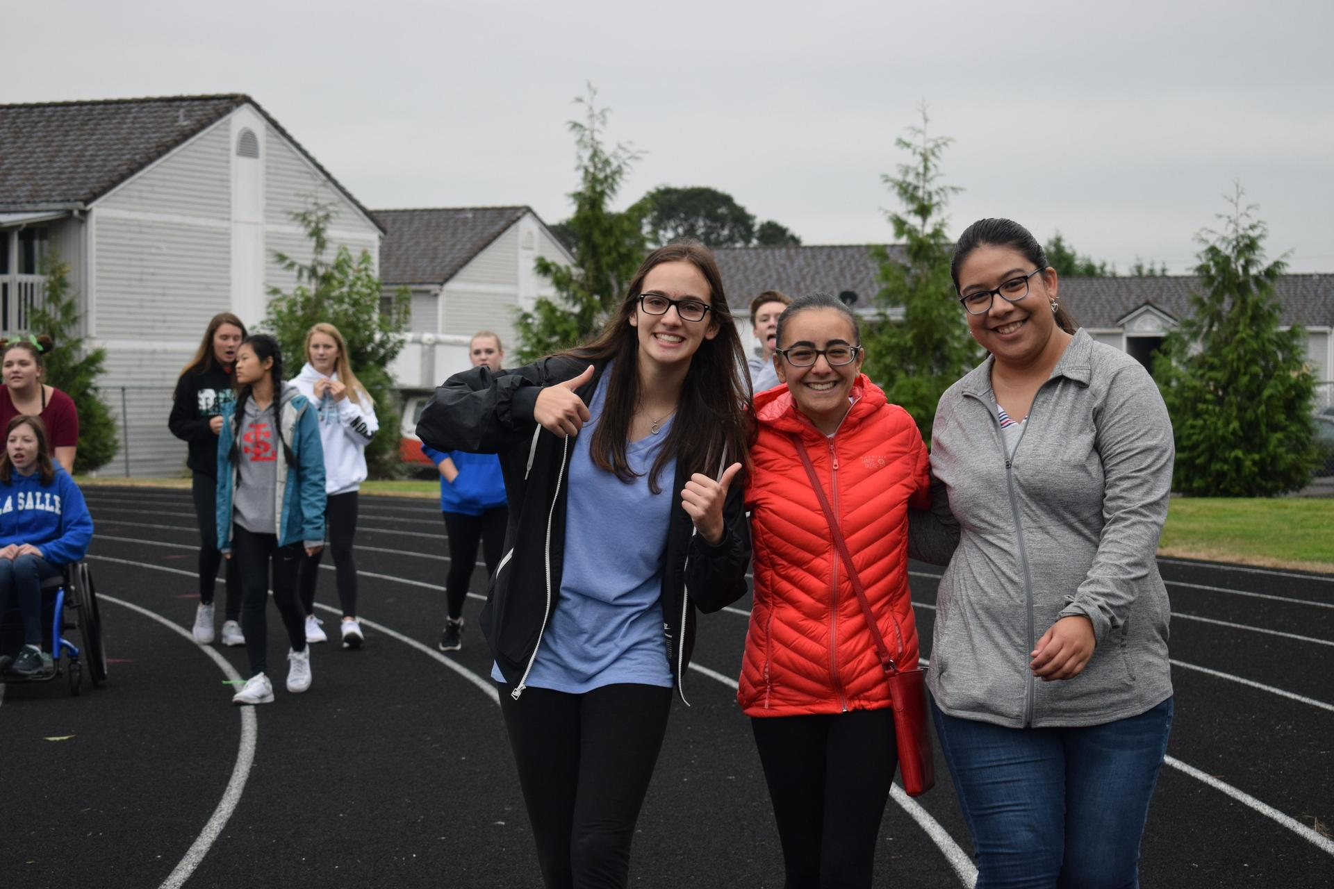 students smile during walk