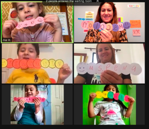 Zoom class holding names written on caterpillars made of paper circles