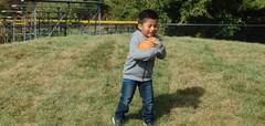Southview students playing outside, boy with ball