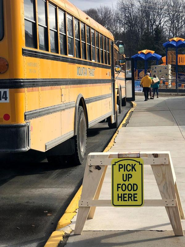 school bus and pick up food here sign