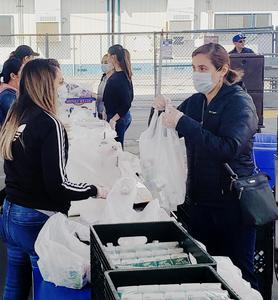 Baldwin Park Unified's Special Education Department, psychology services, custodial staff, school police and Business Department assisted Nutrition Services in serving more than 700 students at Baldwin Park High School on March 25.