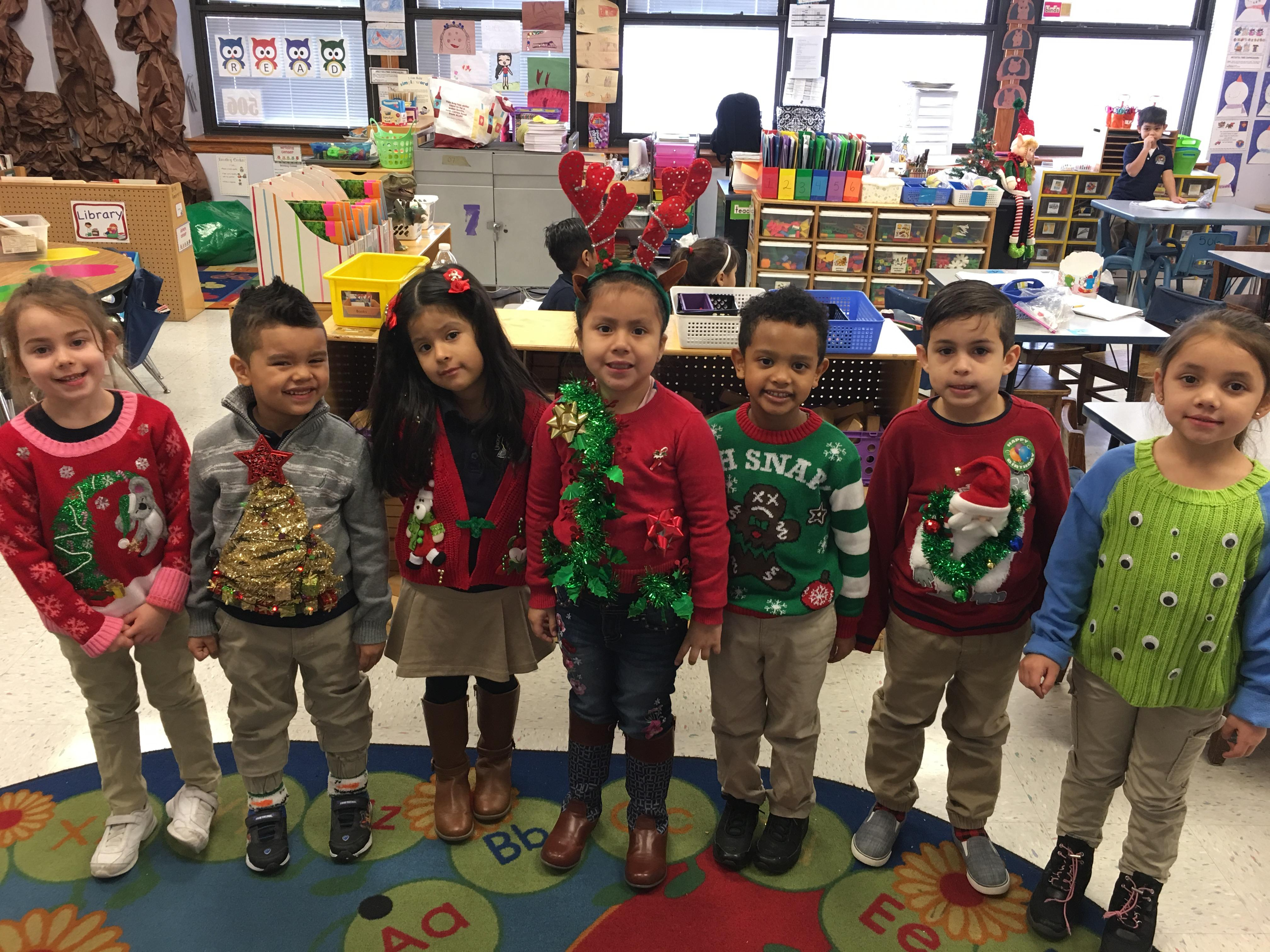 2nd graders showing off their ugly sweaters