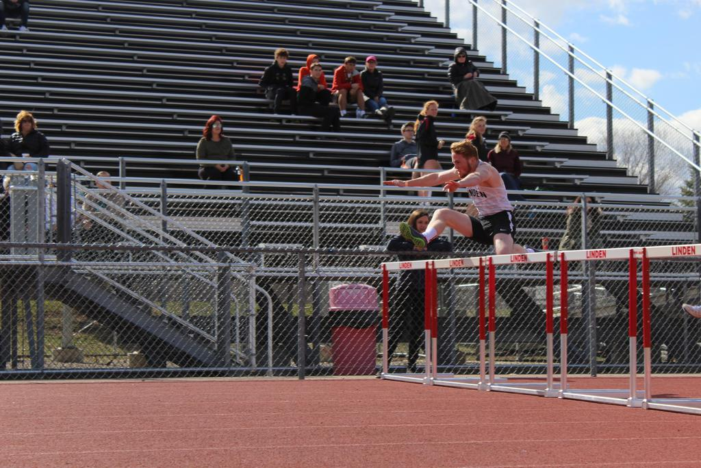 Track athlete jumping hurdles