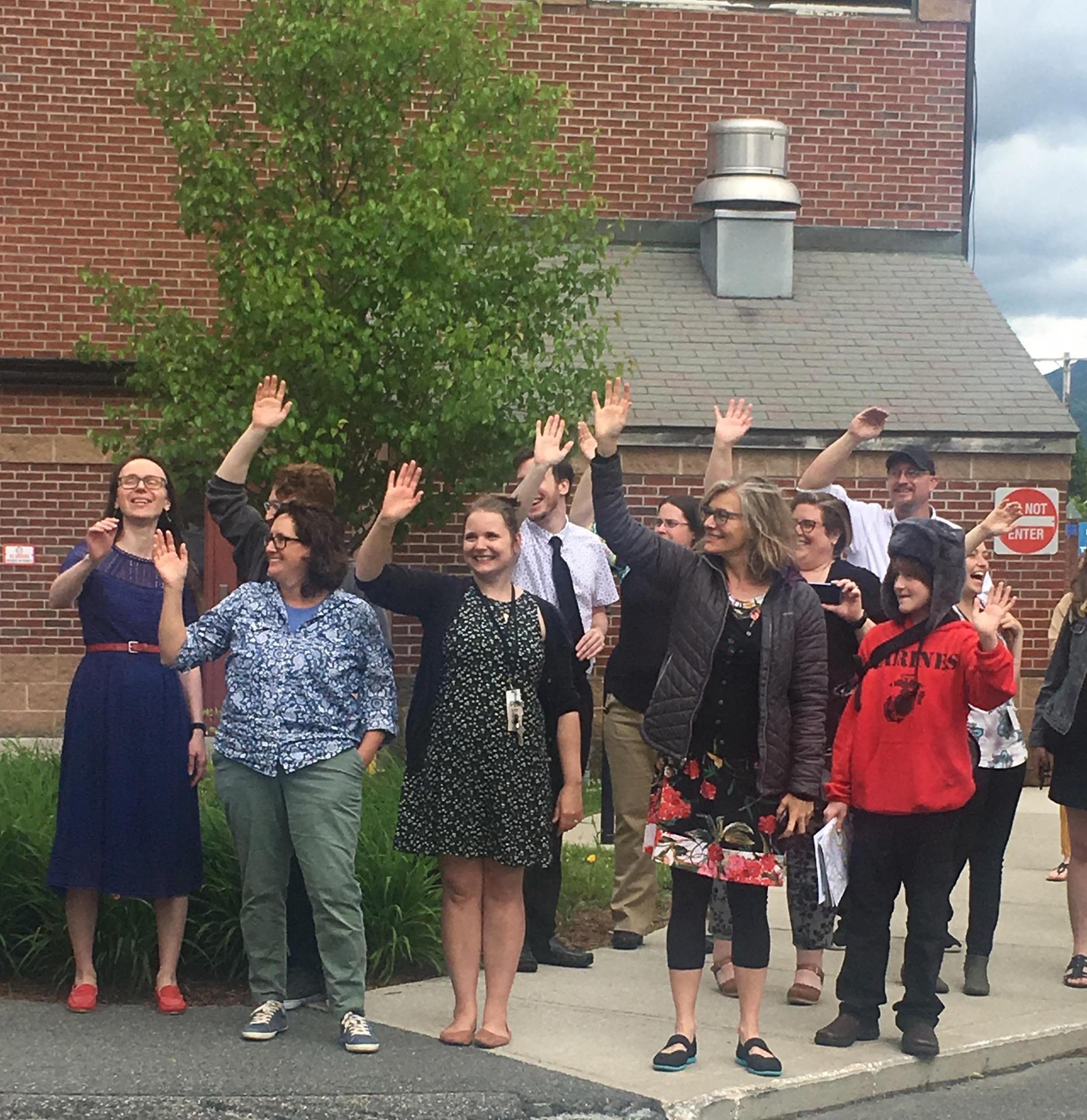 Teachers waving away buses