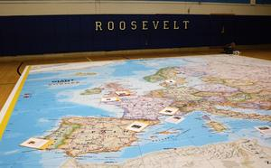 In a geo-scavenger hunt, of sorts, students used latitude and longitude to find an assigned location on the National GeographicGiant Map, set up in the schools' gymnasiums. Once at the location on the map, the students found an envelope with instructions on how to proceed with their lesson on European History.  Pictured here is the Giant Map in the gym at Roosevelt Intermediate School.