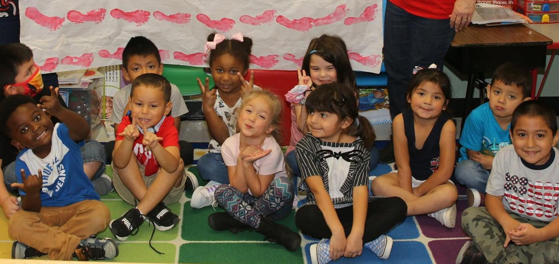PreK students smile for the camera