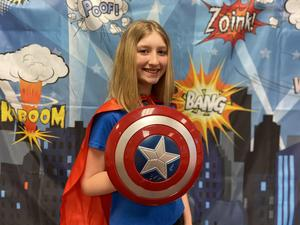 picture of student in superhero outfit