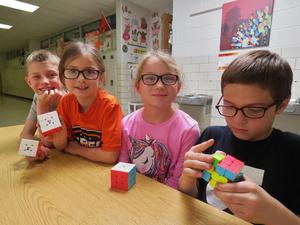 Many of the second graders in Mr. Barnes' class have mastered solving the Rubik's Cube.
