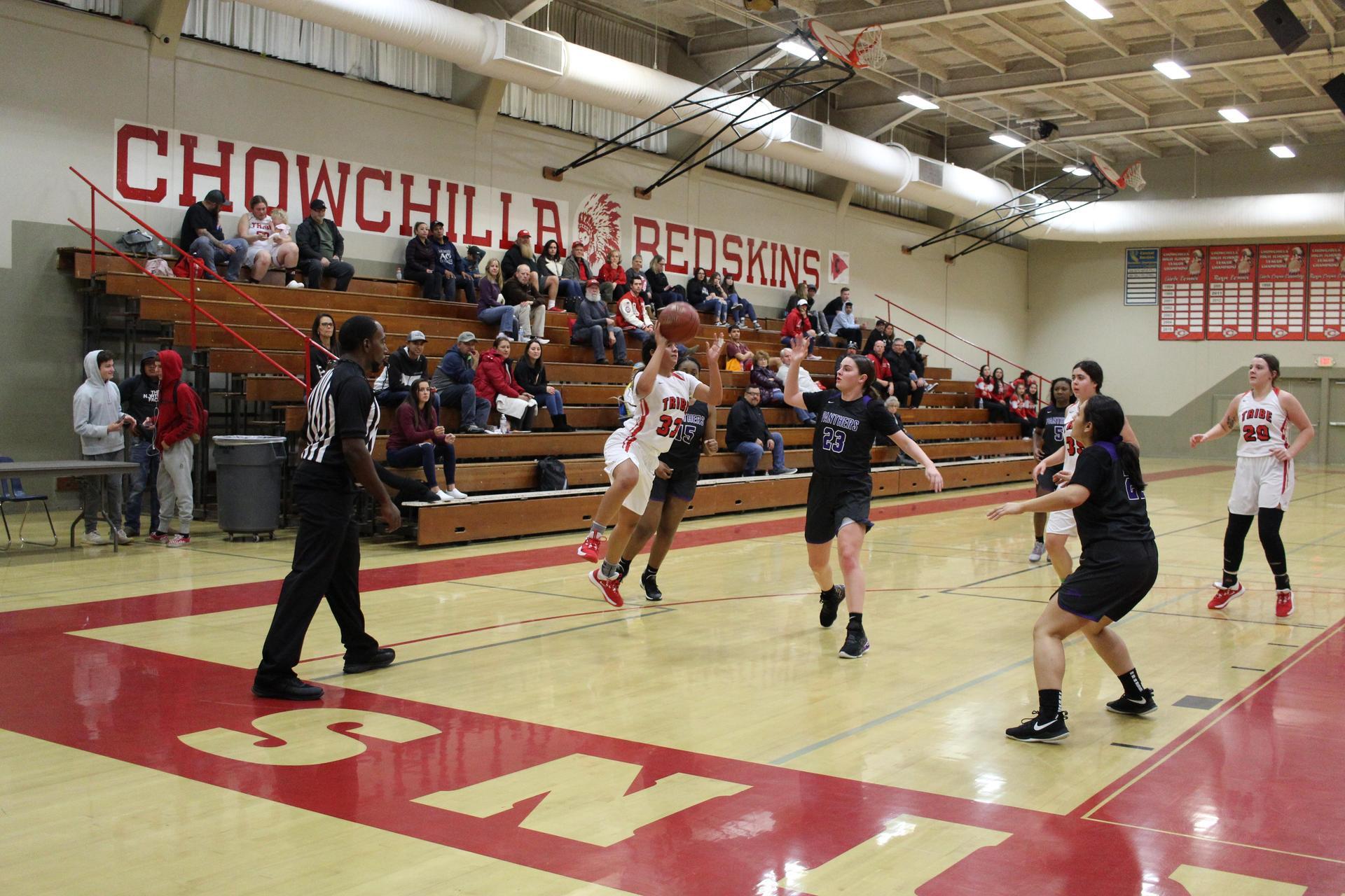 Varsity girls playing basketball
