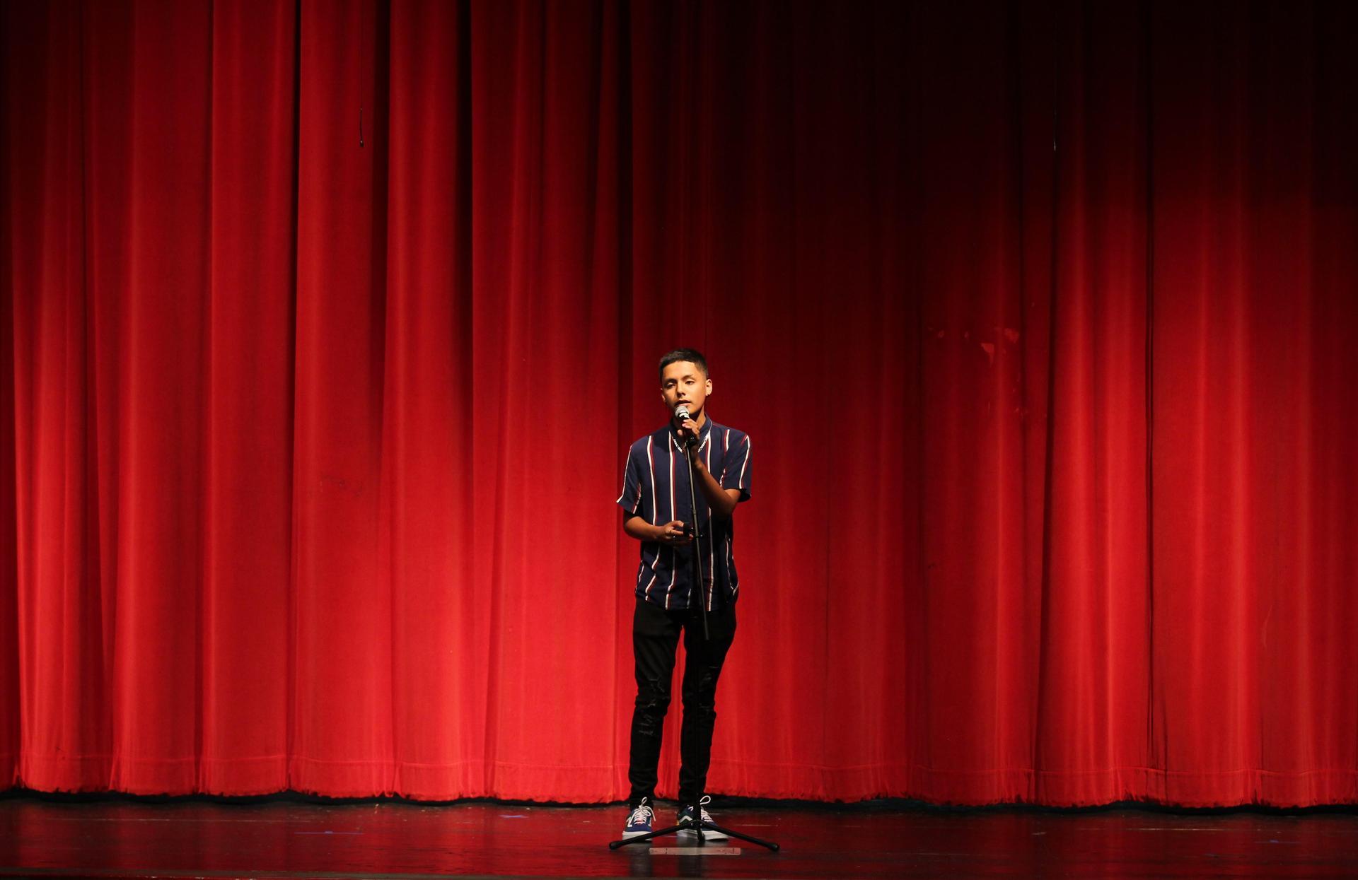 Sebastian Vega singing at the talent show