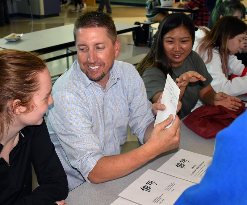 Students work on haikus with teacher