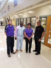 Mr. Wilkes, Dr. Pilot, Ms. Gaither and Mr. McKnight posing for the camera.