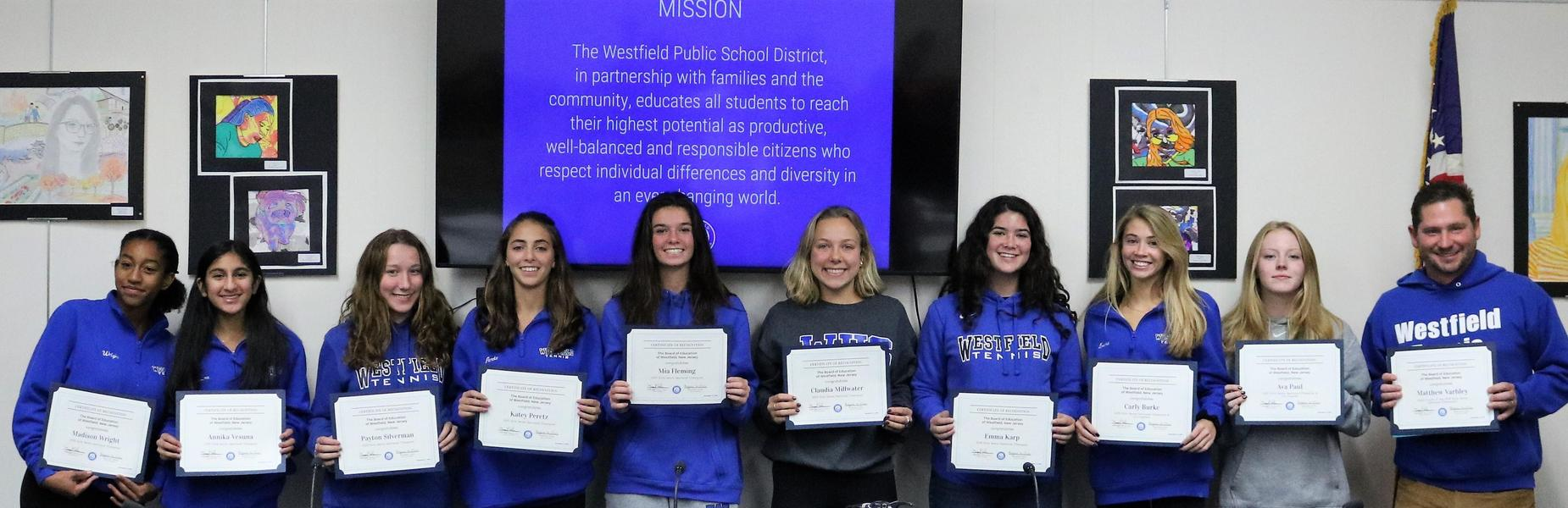 The WHS Girls Tennis Team who, for the first time in nearly a decade won the sectional championship, was recognized at last night's Board of Education meeting.