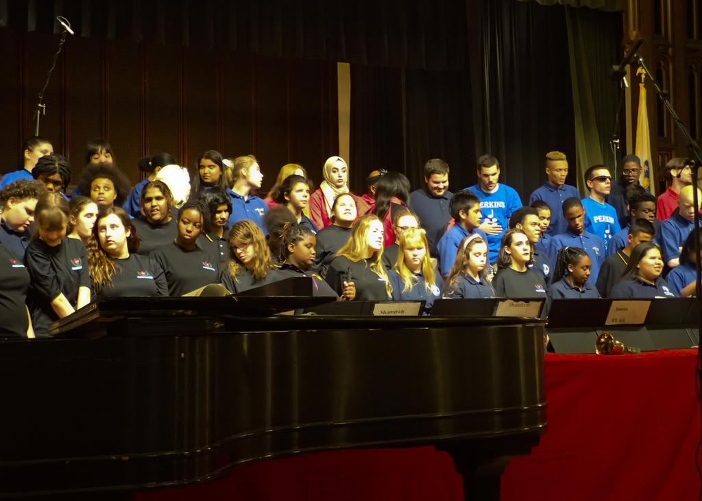 A view of the united choruses from the front row (piano in the foreground)