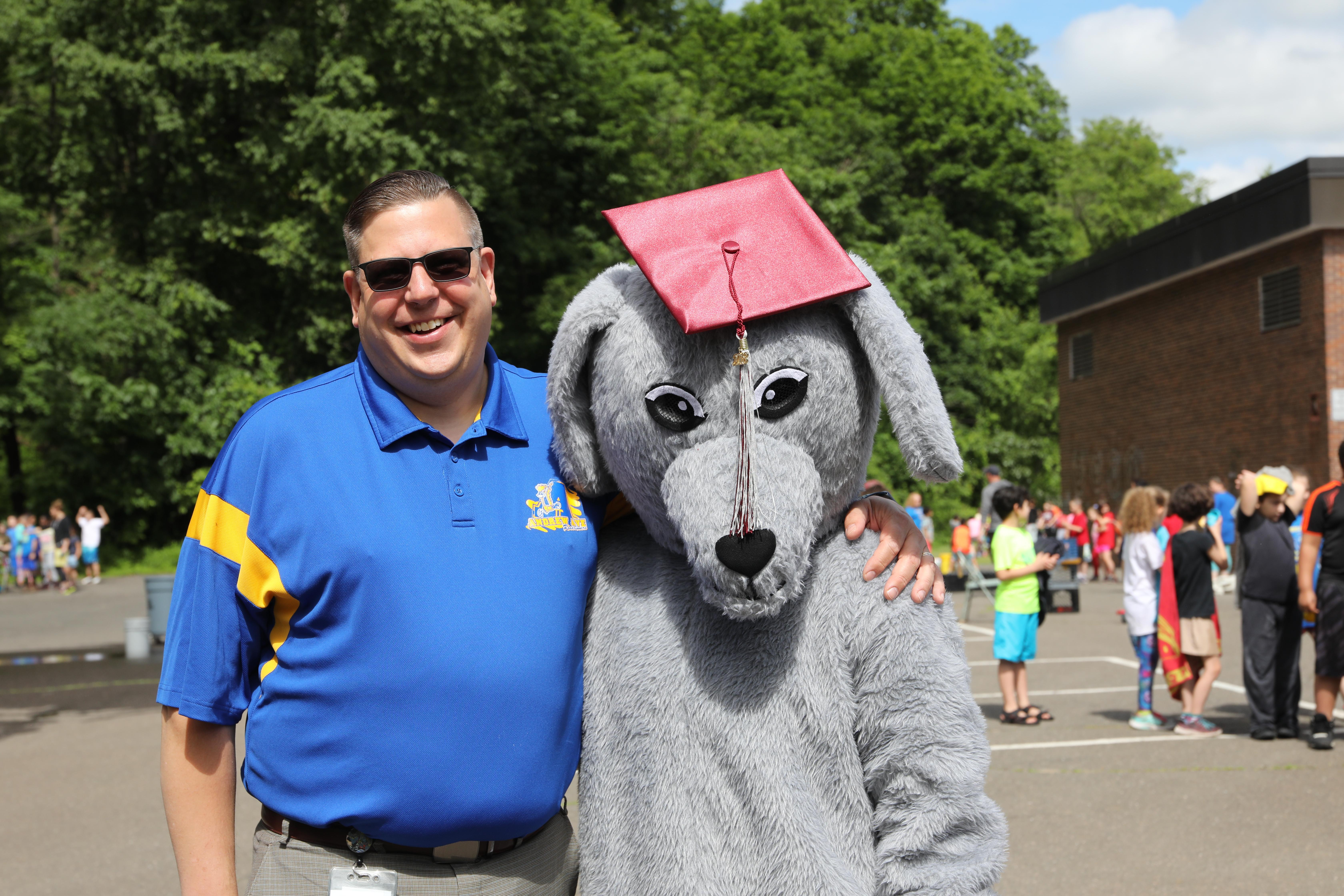 Principal Taran Gruber with greyhound mascot
