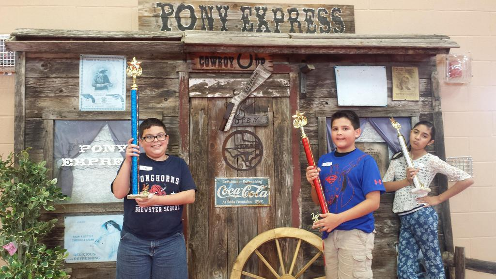 Pony Express - Three Children holding trophies.