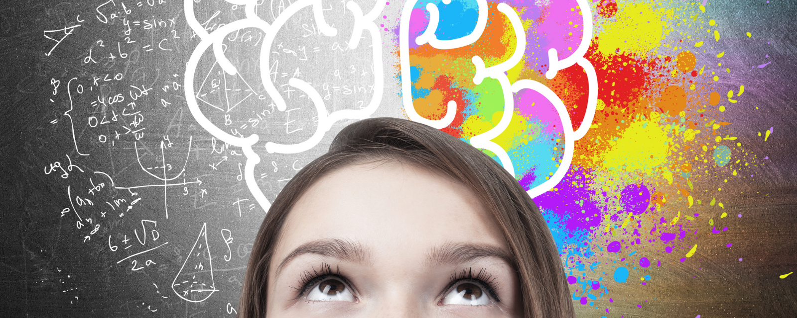 woman looking up at colorful drawing of a brain implying creative thinking