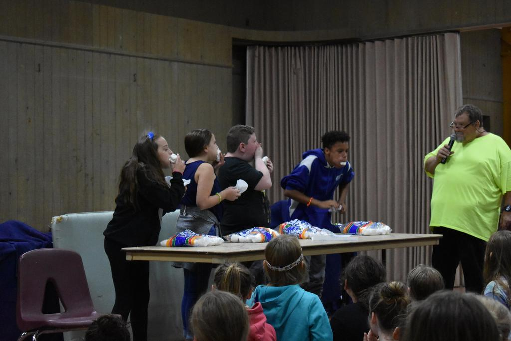 Students eating marshmallows in a contest