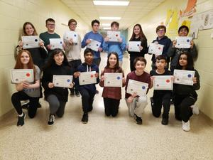 15 middle school students post holding their PJAS Regional competition certificates