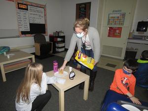 Mrs. Hannapel gives each student a sample of Better Made Chips.