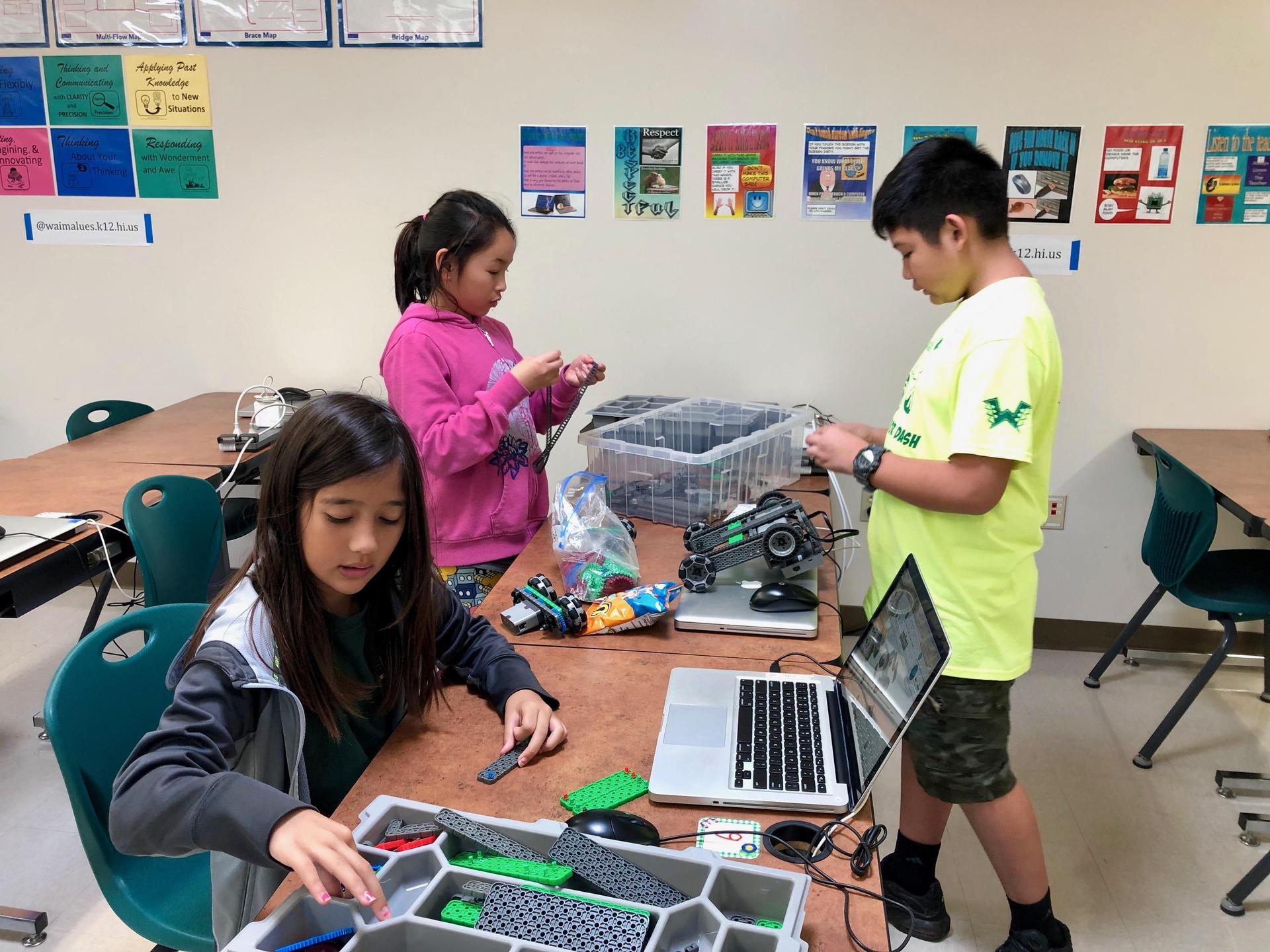Robotics club students work on building robots.
