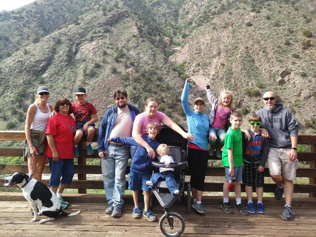 McKinley Families pose on bridge at Tunnel Drive.