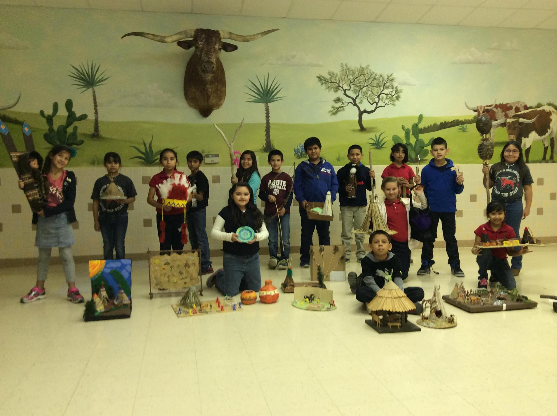 Children holding their American Indian Tribe Project