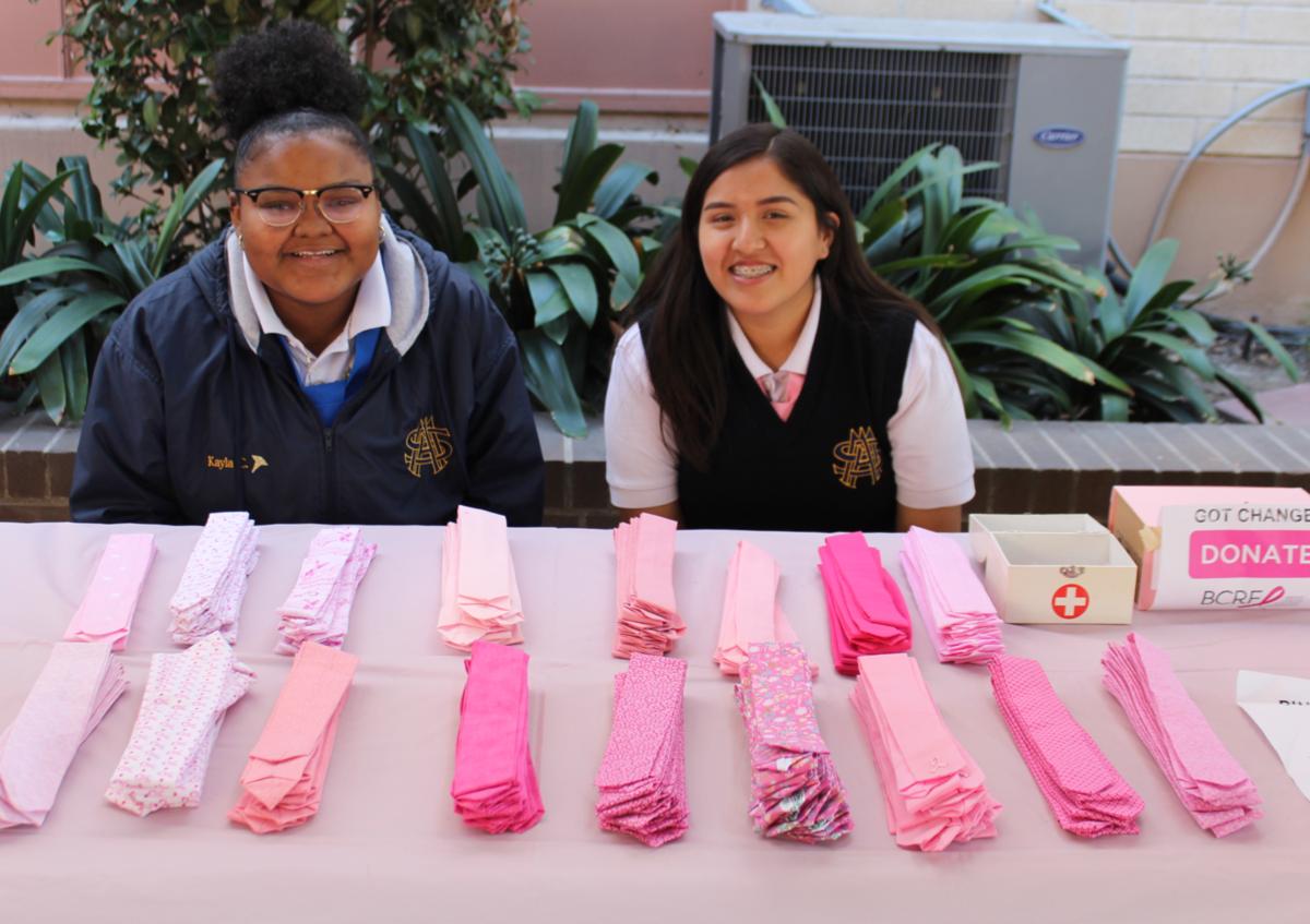 students selling pink ties