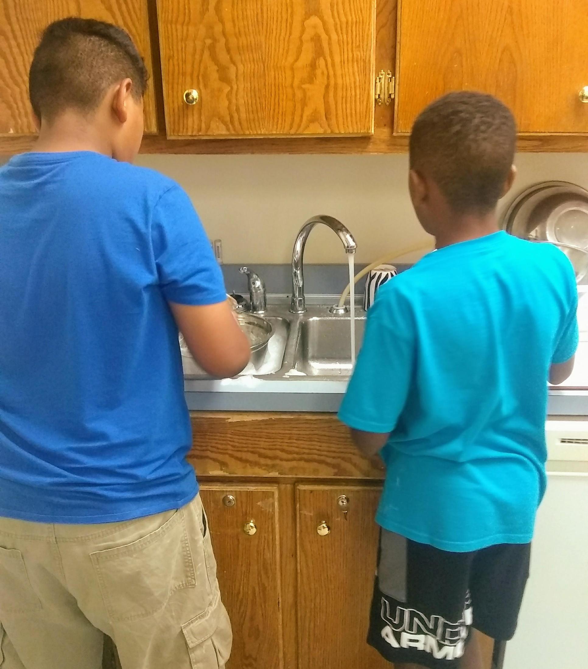 boys washing dishes