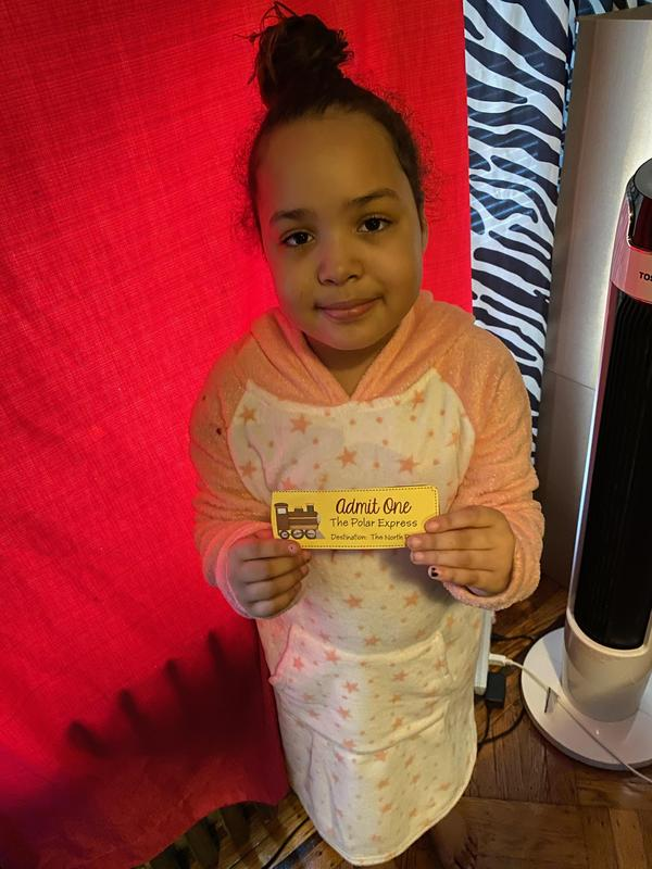 Girl holding yellow ticket