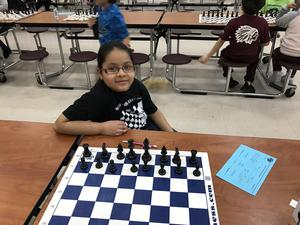 student with chess board.