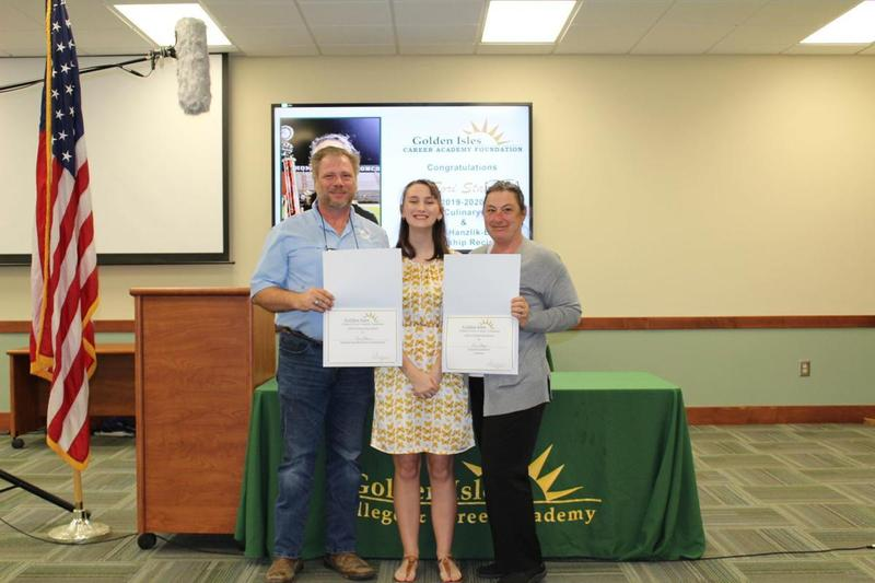 Tori Staat, a recent Glynn Academy graduate and Golden Isles College and Career Academy culinary student, stands with her parents at a recent scholarship ceremony at GICCA.