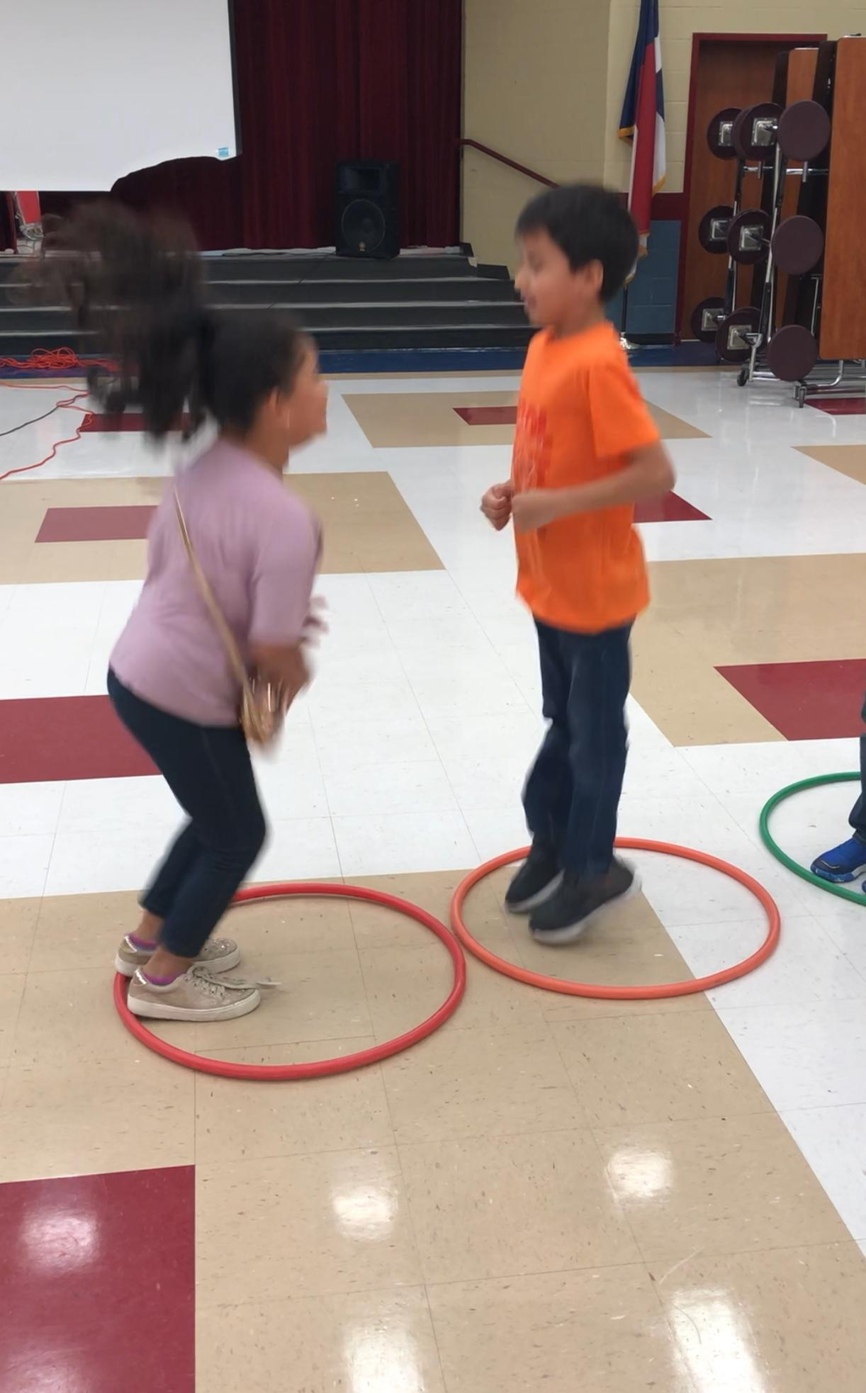 Students jumping in a hula hoop