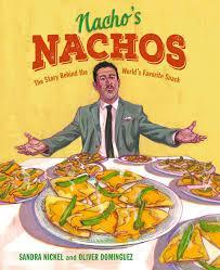 man holding a plate of nachos