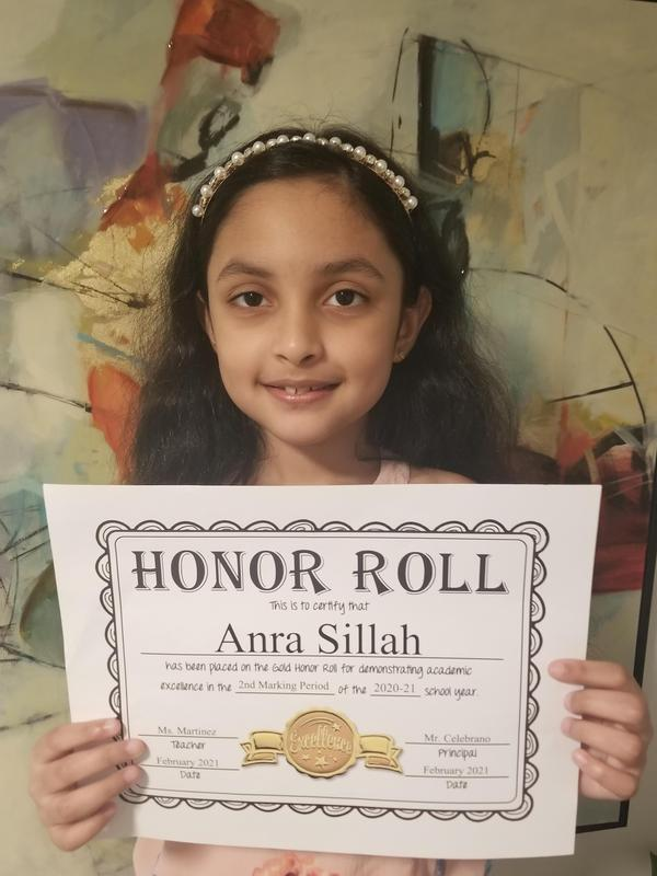 Anra holding honor roll certificate