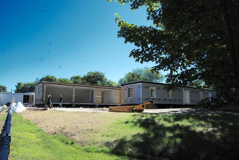 Workers assemble WMS portable classrooms