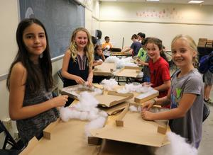 STEM campers build solar ovens in survival course during STEM Camp.