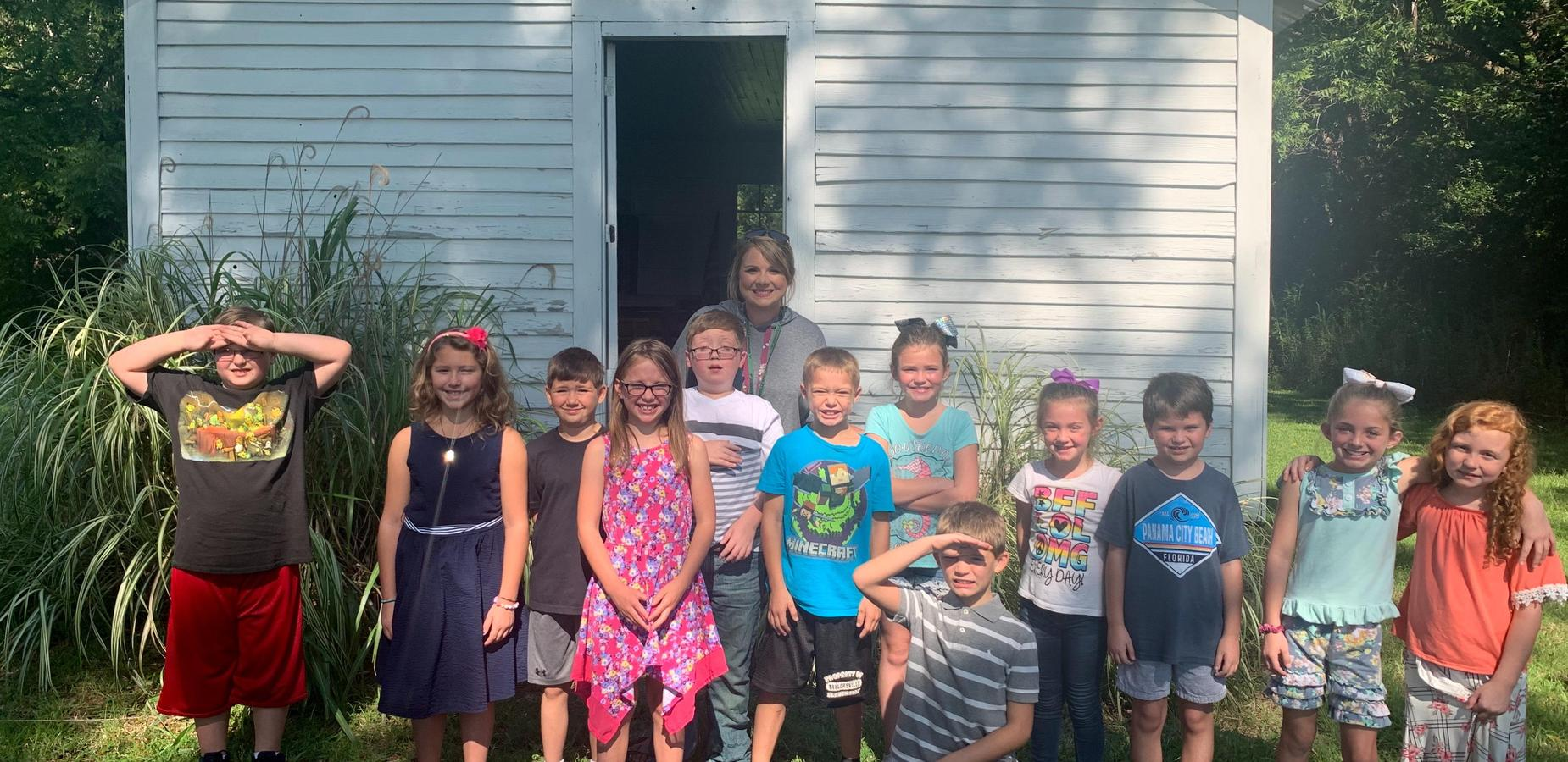 3rd grade students visited the Burnsville one room school house.