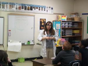 Scientist explains weather information to the class.