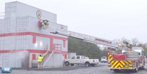 Ladder Truck with people being rescued