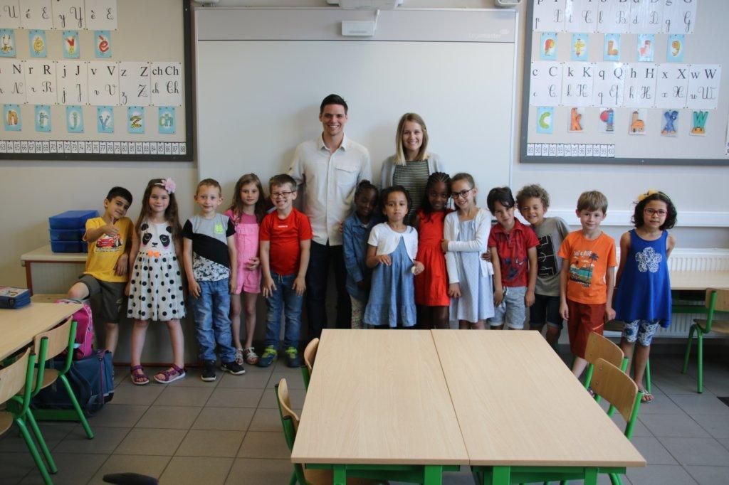 Mrs. Summers and Mr. Summers visiting a first grade class in Belgium