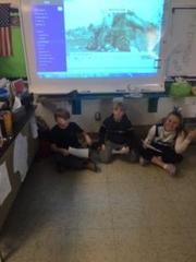 Students acting out an Inuit Family